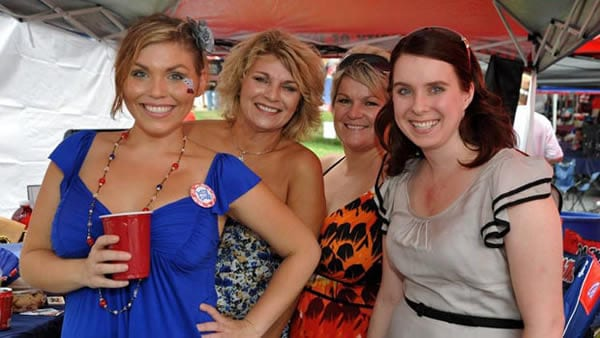 It's no longer just hot dogs and beer. Women have a welcome impact on tailgating quality.
